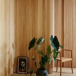 Wood Cladding Wall Idea With Obvious Texture And Wood Color Greenery In Black Pot Midcentury Modern Wood Chair