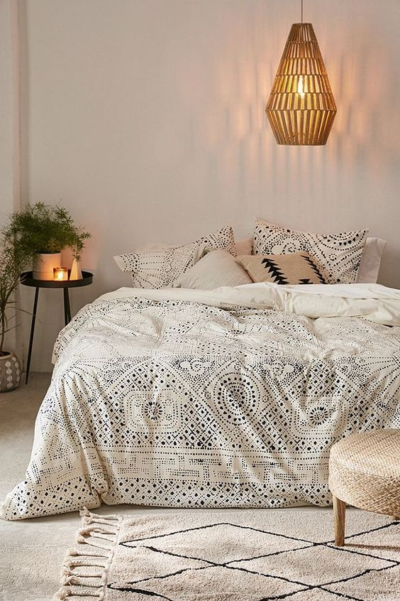 Rowan Bandhani duvet cover by Urban Outfitters woven pendant modern area rug with geometric patterns low profile stool tiny bedside table in black with round top