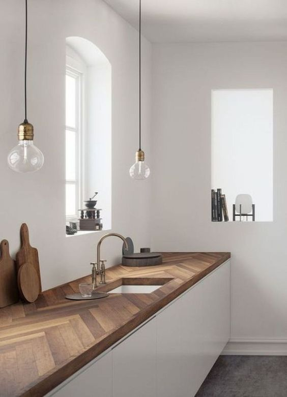 all white kitchen interior white walls reclaimed wood countertop with white kitchen counter base low profile bulb pendants