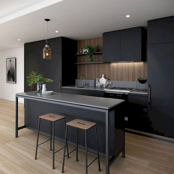 black cabinetry black countertop wood finish backsplash and kitchen walls black bar table dark wood stools in modern style