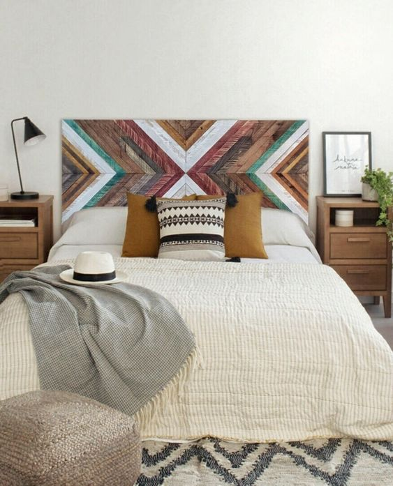 colorful and geometric wood headboard white bed linen and duvet cover gray throw blanket wooden bedside tables