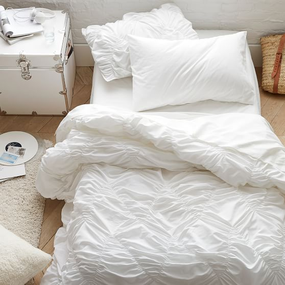 crisp white comforter with waves