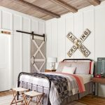 Farmhouse Bedroom Black Finish Metal Bed Frame With Headboard And Footboard A Couple Of Director Chairs Vintage Area Rug With Modern Geometric Patterns