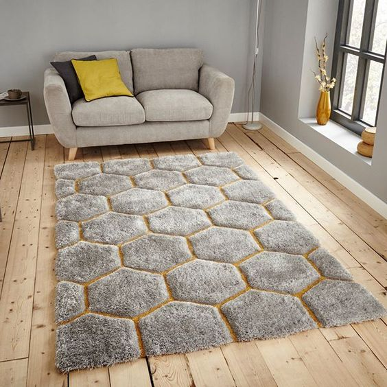 gray area rug with yellow accents gray loveseat in midcentury modern style