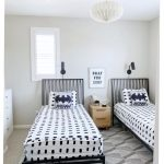 Kids' Room With Twin Bed Frame With Headboard Monochromatic Bed Treatment Modern Area Rug With Geometric Patterns Crisp White Walls
