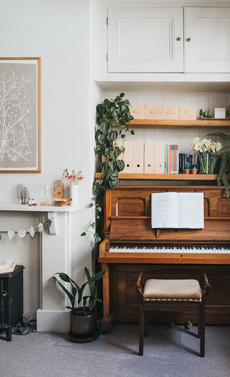 music corner filled with piano and stool
