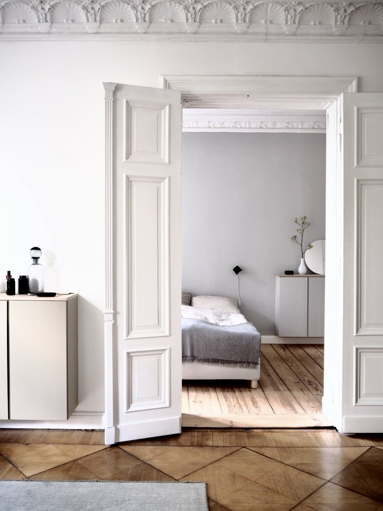 organic wood plank floors white bed frame gray bedding idea floating dresser with frameless round shaped mirror on top