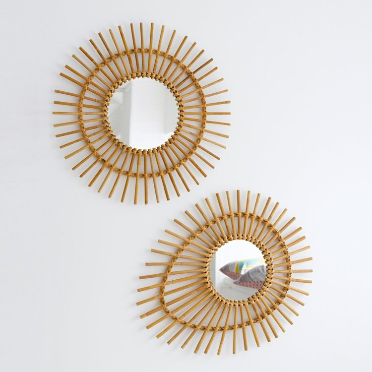 ornate wall mirrors with rattan frames and rays of rattan sticks