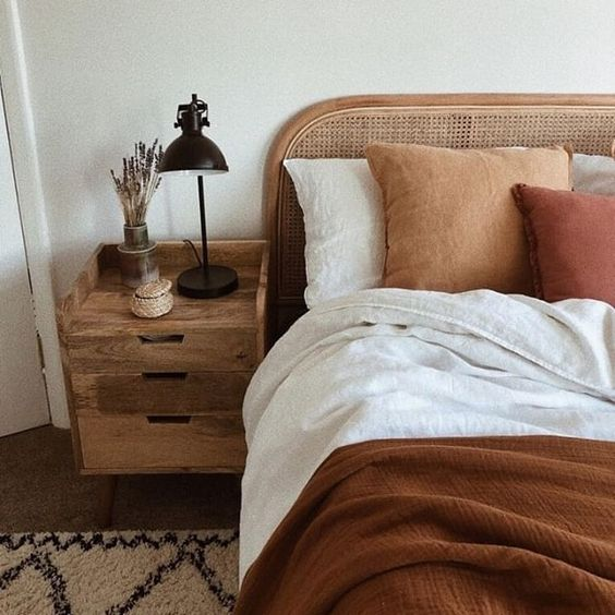 rattan bed frame with headboard solid wood nightstand rust duvet cover burnt orange pillow