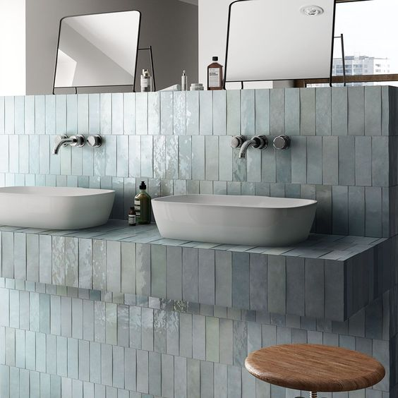shimmering gloss tiles in light gray for bathroom vanity double sink in white black framed mirrors