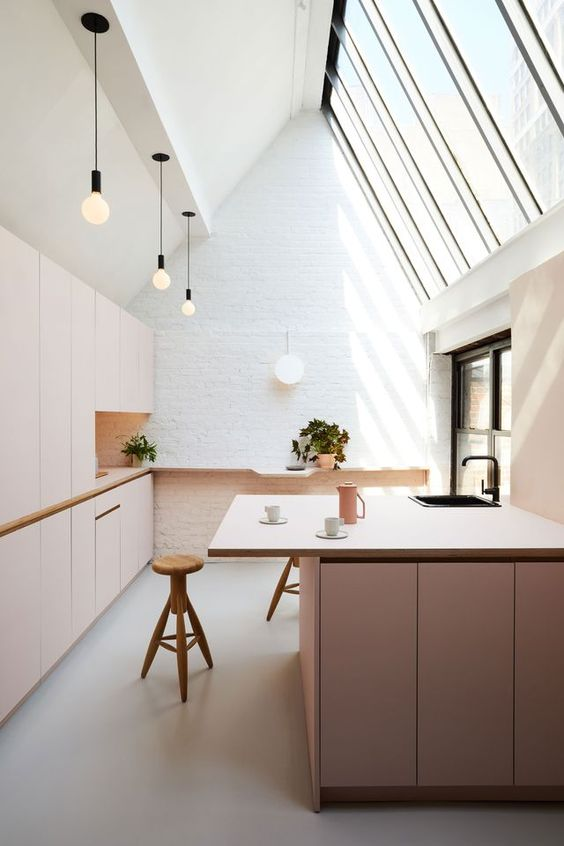 ultra light wood cabinetry clean look kitchen island with light wood top wood stools huge skylight in slanted installation