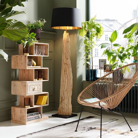 unique wood shelving unit floor lamp with woody stem tree stand and black lampshade rattan reading chair with wire support on its seat