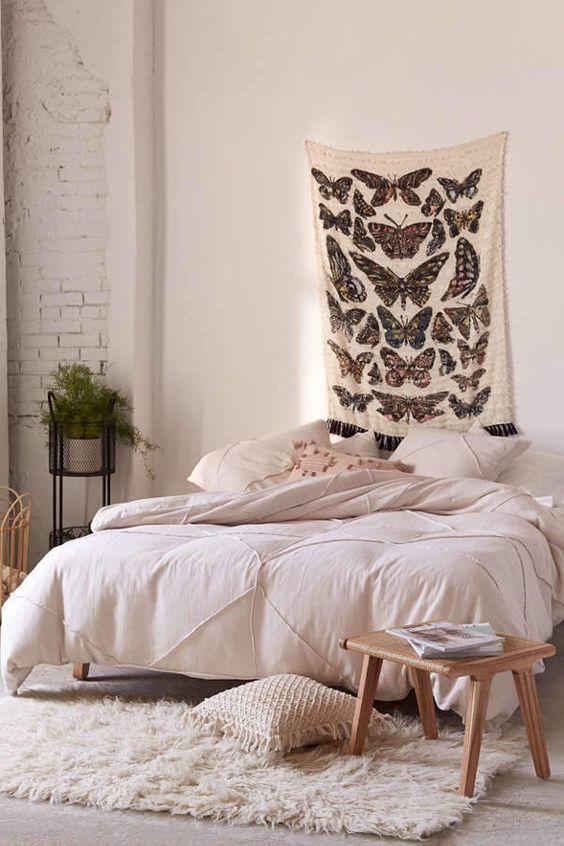 wall art with butterfly prints white bedding treatment white shag rug runner wooden stool with square top