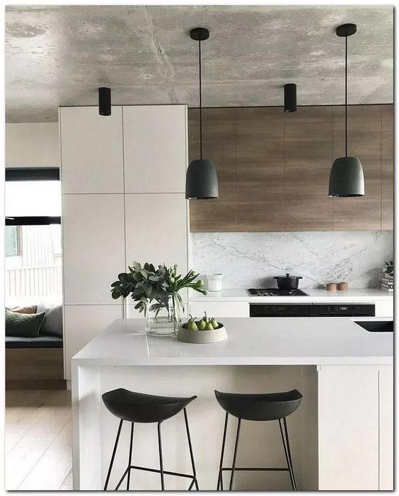 white kitchen island as well as breakfast nook black stools in modern style flat door cabinets in white marble backsplash wood paneling above the stove