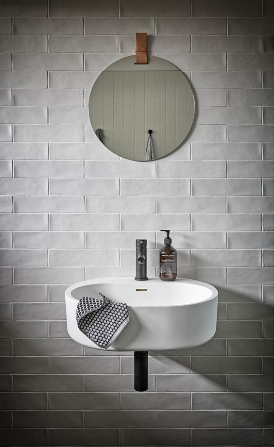 white subway tile walls with no grout for Scandinavian bathroom wall mounted sink in white frameless wall mirror in round shape