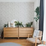 Wooden Console Tables Bright Wallpaper With Motifs Some Greenery On Tables Frameless Round Mirror Midcentury Modern Chair With Light Milo Leather And Wood Frame Wooden Floors Round Area Rug In Light Blue