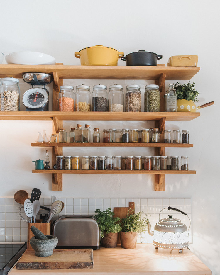 wooden rack for well organized jars and cooking tools