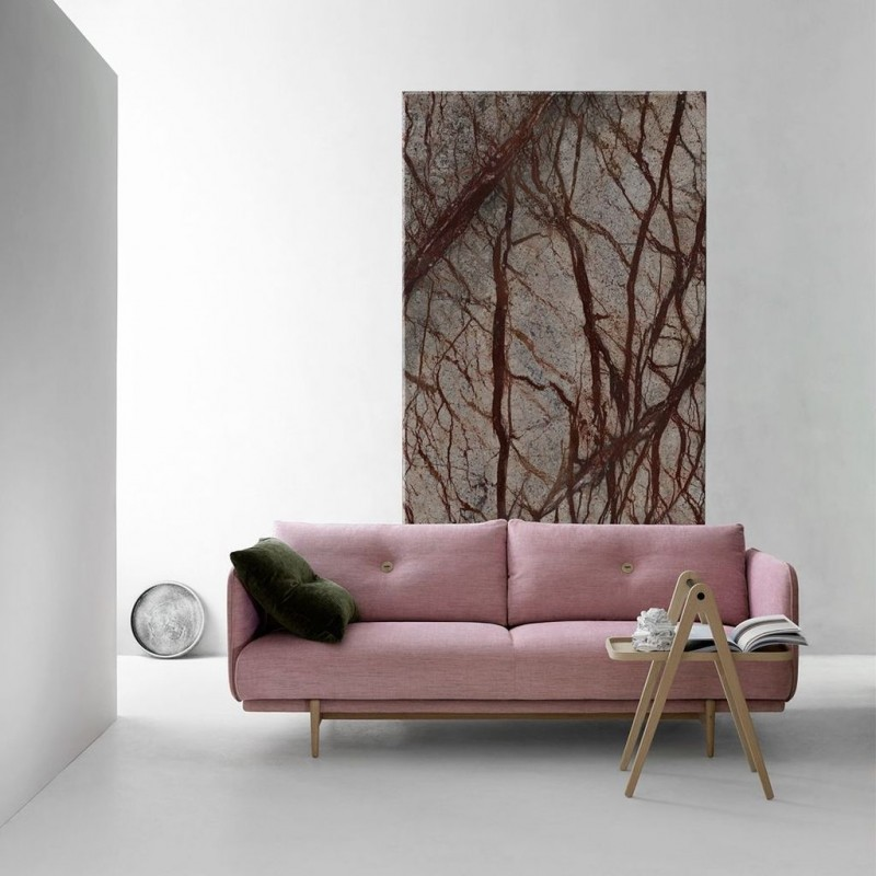 Scandinavian sofa in soft pink with wooden frame unique coffee table made from light wood artsy painting arts