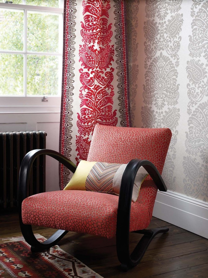 accent chair with textured coral upholstery and black finish wooden frame