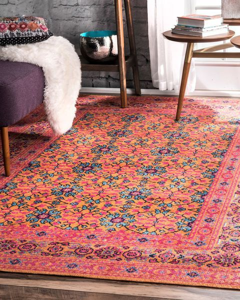 cool area rug with coral base color and multicolored motifs