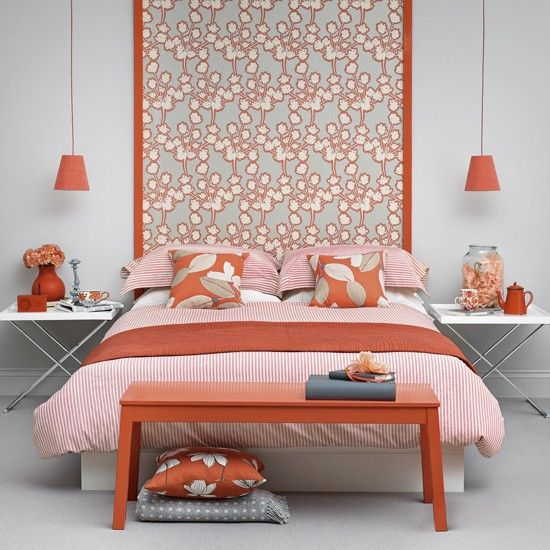 coral bedroom idea with striped coral bed linen and pillows a couple of hanging light fixtures with coral lampshades x base bedside tables coral colored bench bed