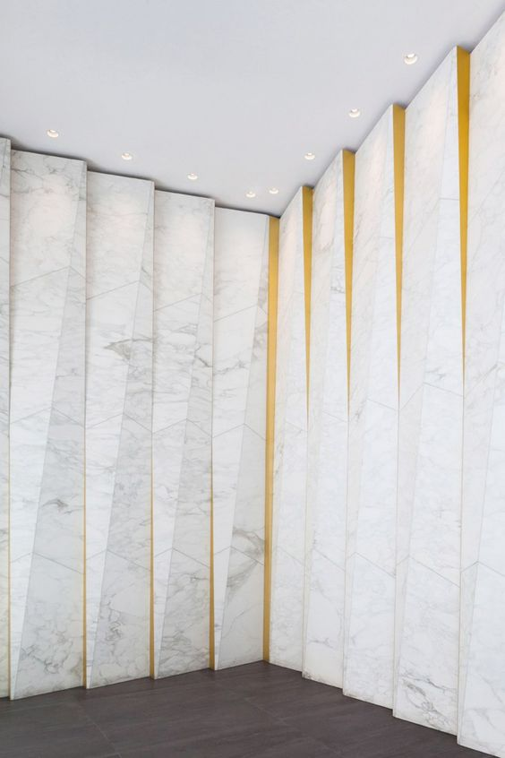 great interior facade built from calcatta marble featuring bronze coated aluminum