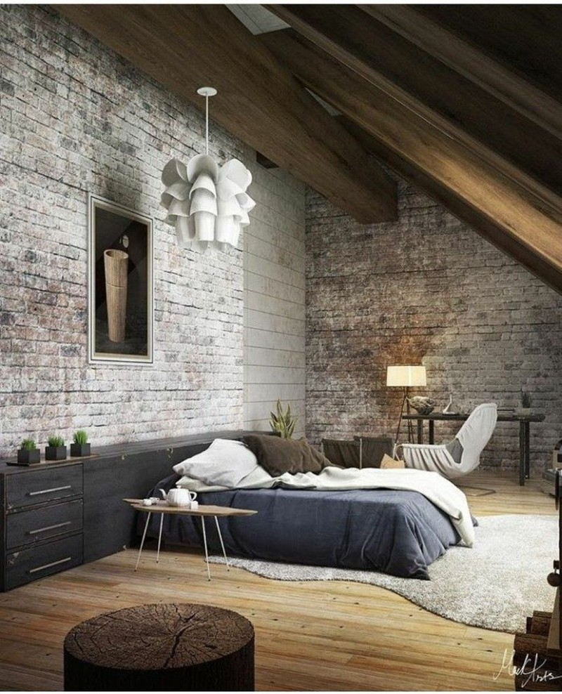 industrial loft bedroom with shabby white washed brick walls bigger cabinets in black gray area rug wood top side table with tiny metal legs light wood floors
