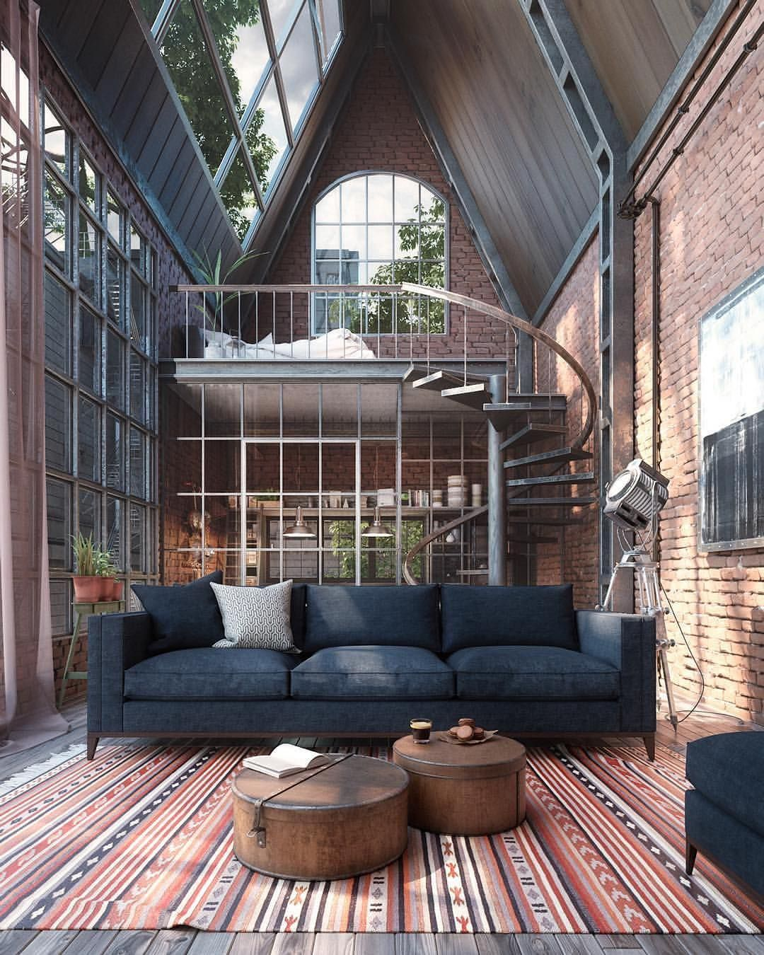 industrial loft design midcentury modern sofa in black twin coffee table with round shape tops tribal area rug twister staircase