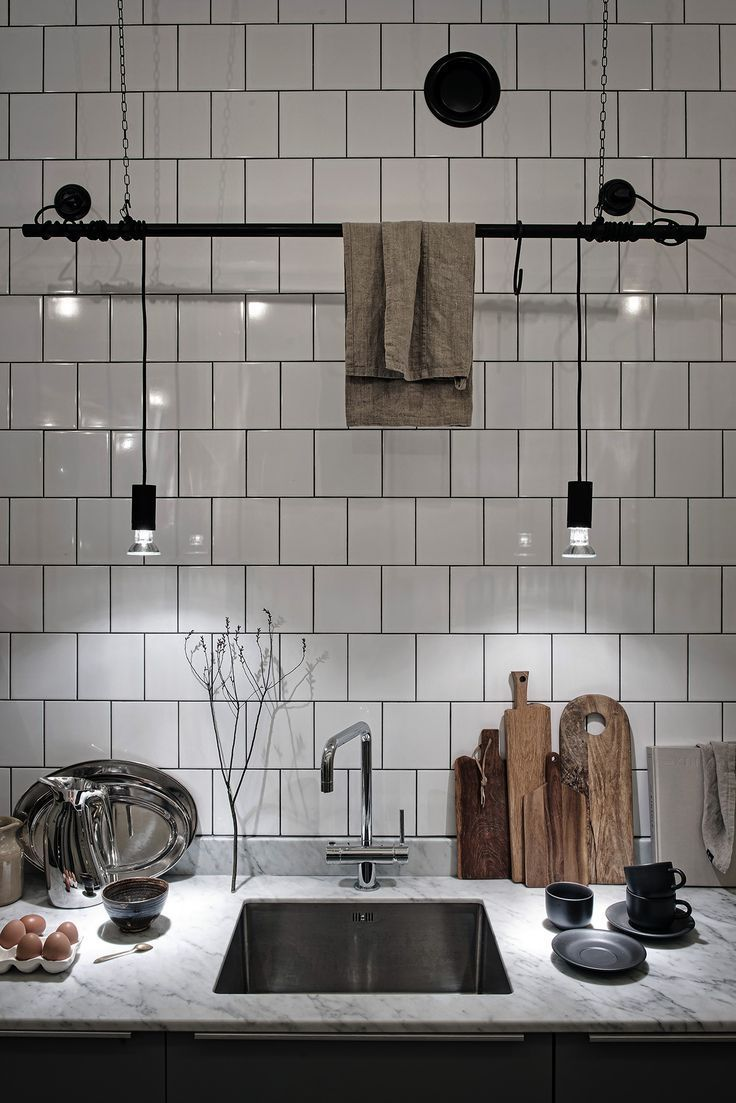 industrial loft kitchen idea with white ceramic subway tile backsplash and walls marble countertop square shape sink stainless steel faucet