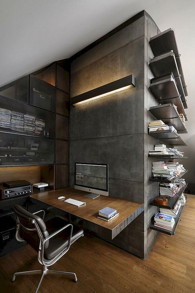 industrial style loft workspace idea hard concrete walls wall mounted working desk movable working chair wall mounted book shelves