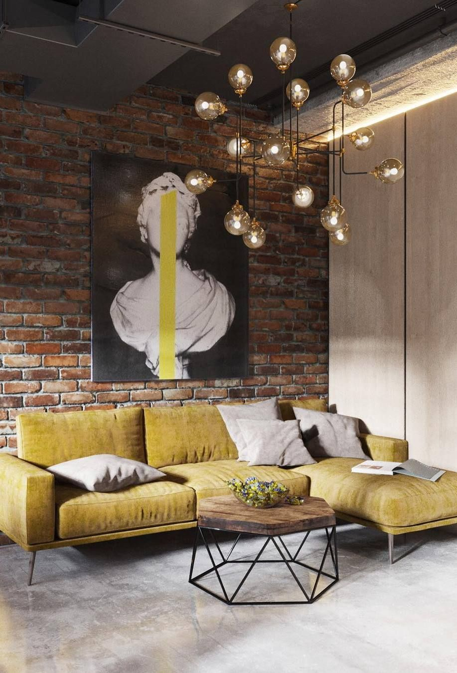 modern industrial loft with brick walls yellow sectional sofa industrial coffee table with wood top artsy painting