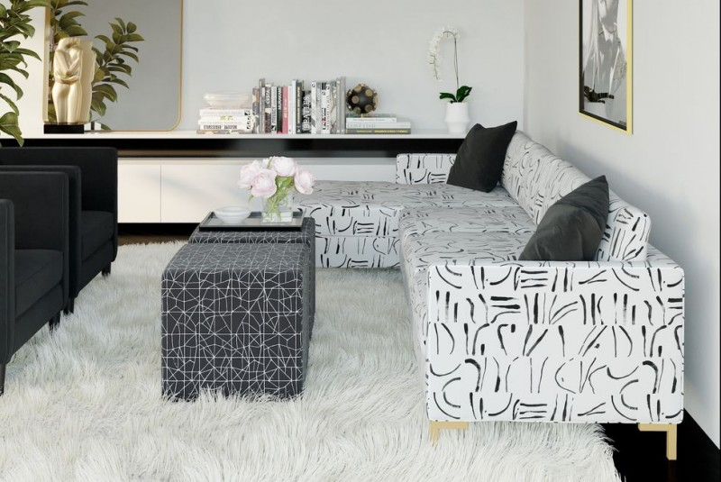 modern sectional sofa with modern black motifs modern black coffee table with complicated white motifs white shag rug