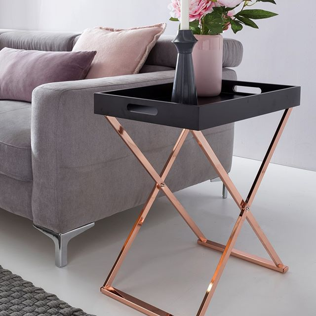 modern tray side table with black top and elegant X brass base