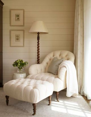 ottoman inspired arm chair with white tufted cushions and handcarved wood legs