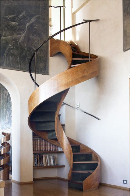 spiral staircase with mini bookshelves underneath