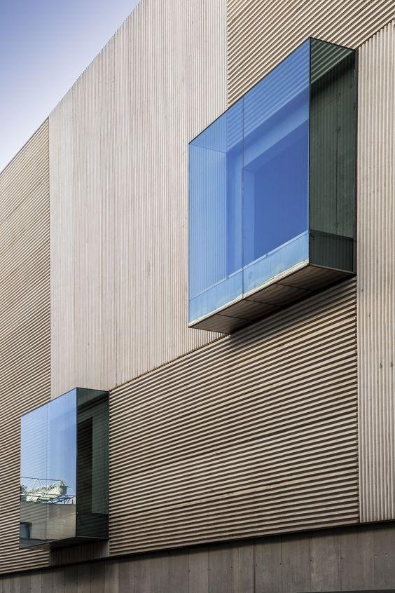 stunning glass windows textured concrete wall exterior