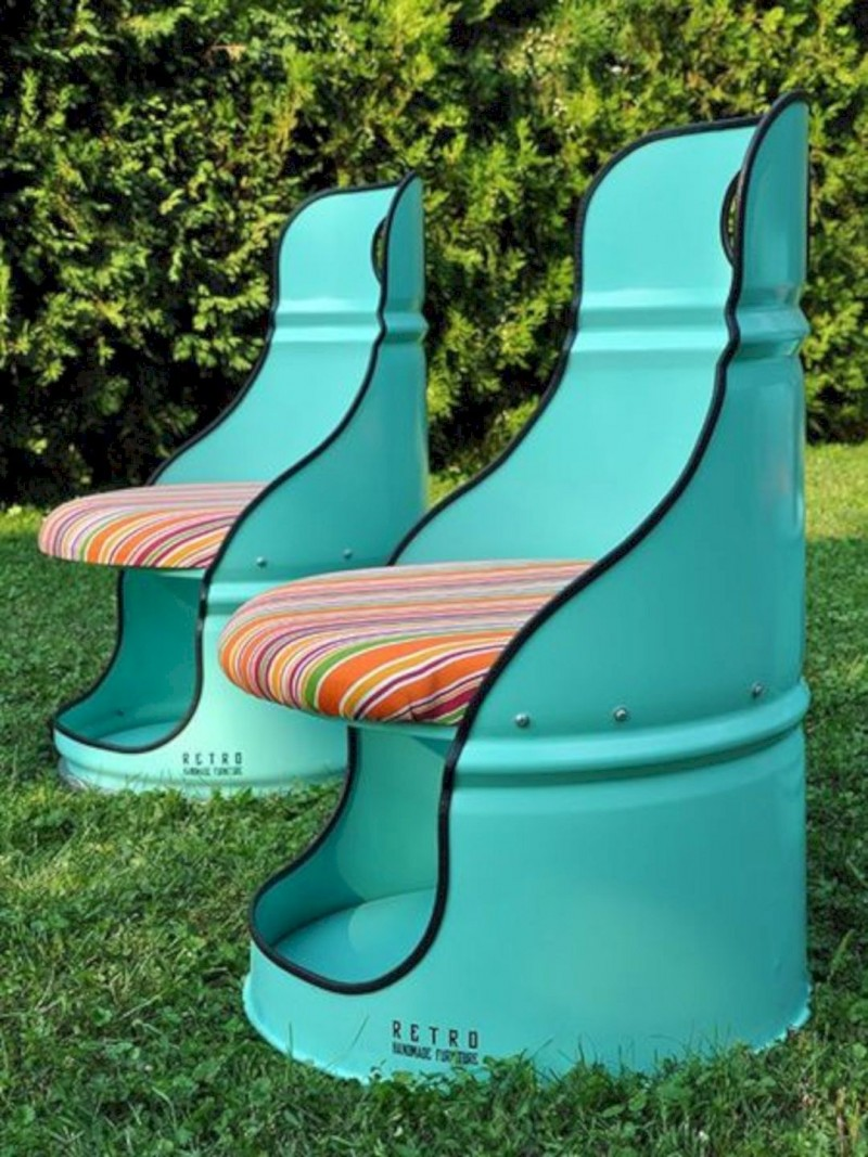 upcycled drum barrel chairs with colorful stripes cushion
