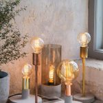 Various Trendy Lighting Fixtures With Concrete Base