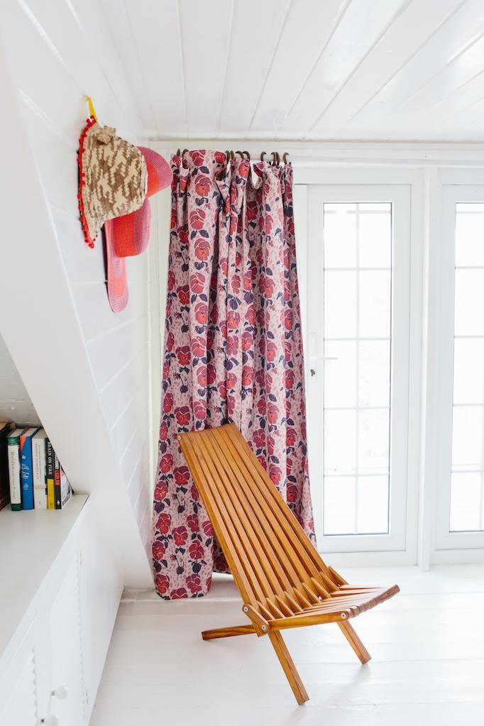 window curtains with coral flower motifs wooden reclining chair