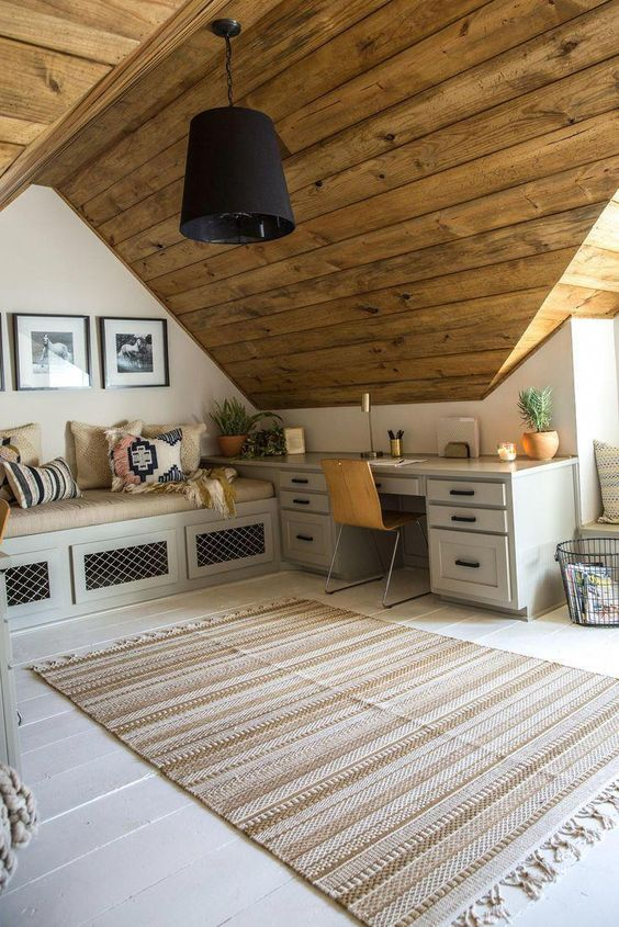 wood attic ceilings white walls bright schemed daybed and working table light toned area rug black pendant