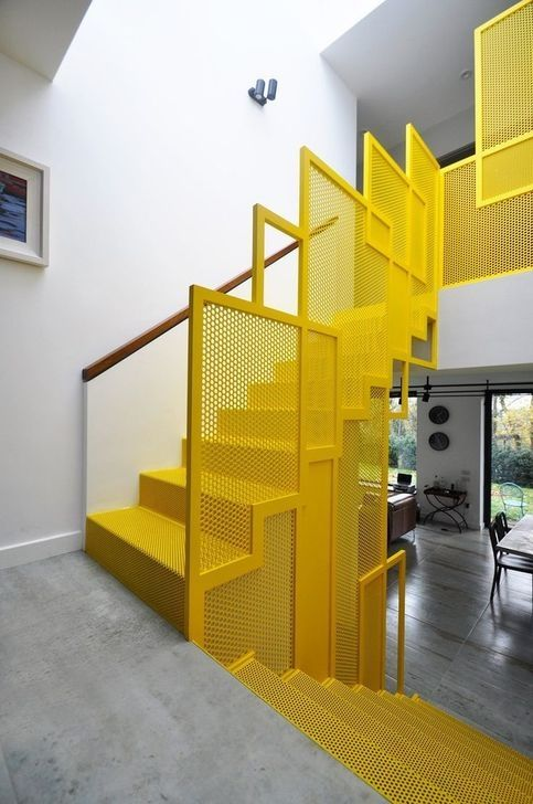 yellow contemporary staircase idea with asymmetrical and small holed railings