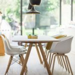 Scandinavian Style Dining Room With White Top Dining Table White Dining Chairs With Wood Legs Light Wood Floors