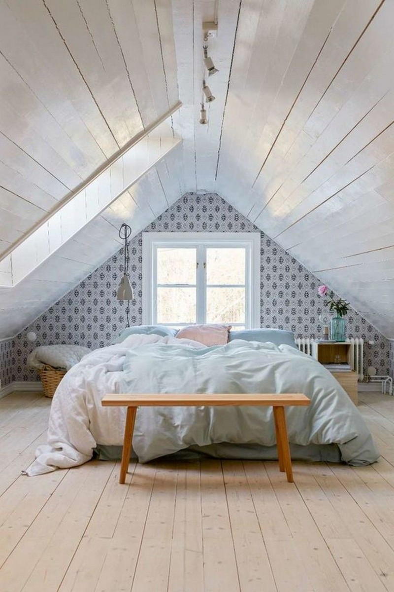 attic makeover idea white duvet cover wood bench bed wallpaper wood plank ceilings in white with skylights