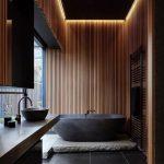 Black Bathtub With Black Stone Base Black Ceramic Tile Floors Black Bathroom Vanity With Black Sink And Faucet Ornate Wood Wall Accent