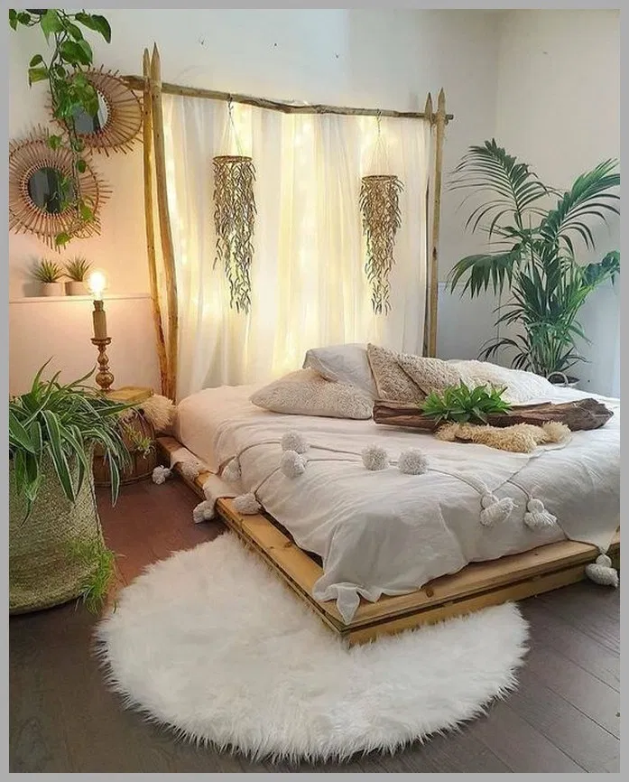 boho style bedroom with platform bed frame with ornate drapery in white white bedding treatment with pompom round shaped shag rug in white some greenery