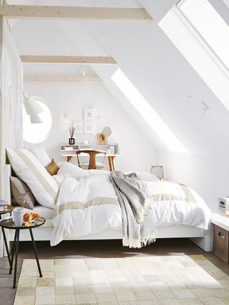 bright and airy attic bedroom with white bedding treatment white walls white tile floors