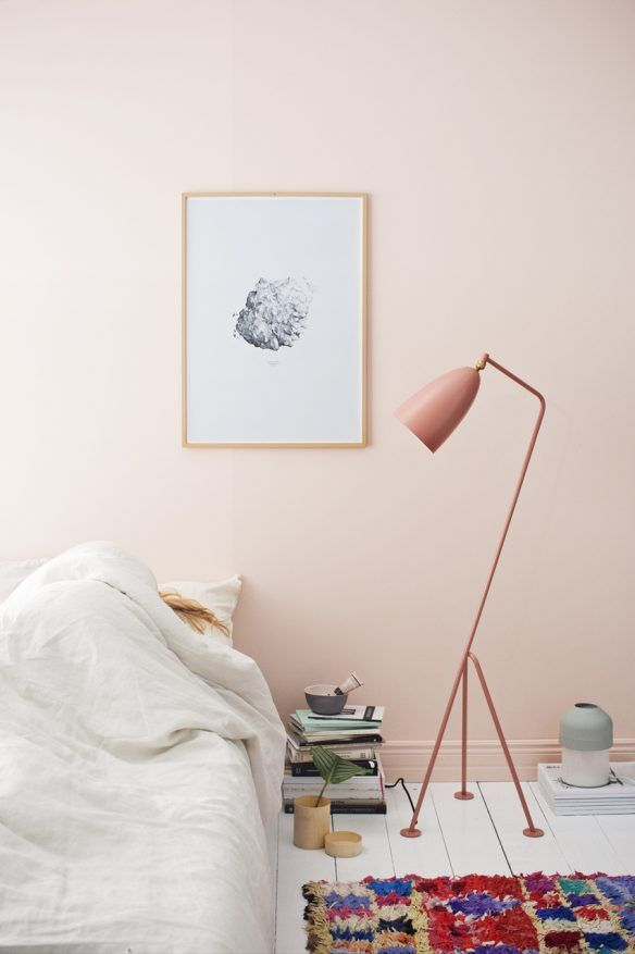 bright and light bedroom idea with white bedding colorful rug modern floor lamp in soft blush pink
