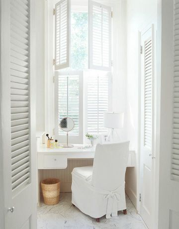 clean and fresh makeup area with white chair slipcover built in dressing table in white white window shutters