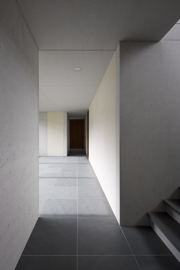 corridor displaying modern minimalist interior dominated by whites