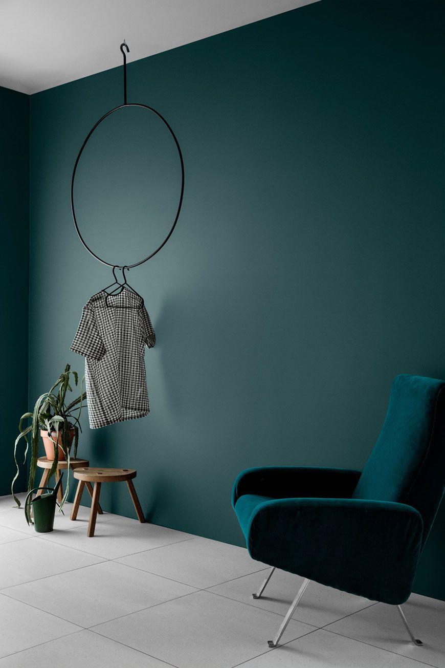 deep ivory wall color deep blue velvet chair wooden stools for greenery white tile floors